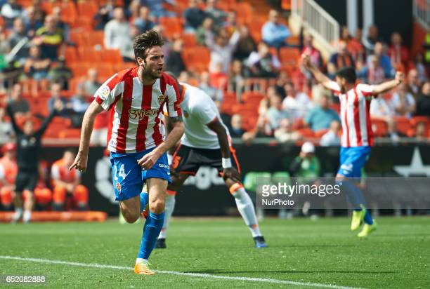 Duje Cop of Real Sporting de Gijon celebrates his goal during their La Liga match between Valencia CF and Real Sporting de Gijon at the Estadio de...