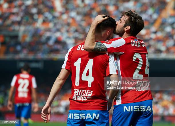 Duje Cop of Real Sporting de Gijon celebrates with Burgui after scoring a goal during the La Liga match between Valencia CF and Real Sporting de...