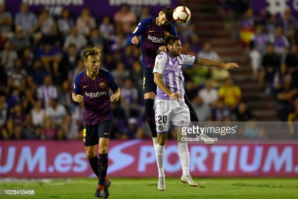 Duje Cop of Valladolid competes for the ball with Gerard Pique of Barcelona during the La Liga match between Real Valladolid CF and FC Barcelona at...