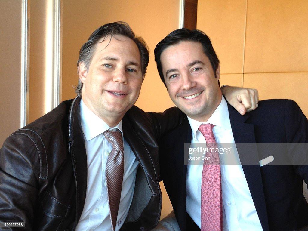 DuJour Magazine's Jason Binn and coach Roberto Lorenzini pose circa October 2012 in New York City.