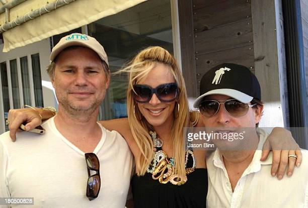 DuJour Media Founder Jason Binn Alison Brod or Alison Broad Public Relations and entrepreneur Charlie Walk pose circa August 2013 in New York City