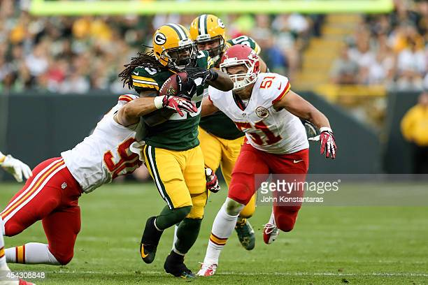 DuJuan Harris of the Green Bay Packers runs with the ball as Josh Mauga and Frank Zombo of the Kansas City Chiefs approach from behind in the first...