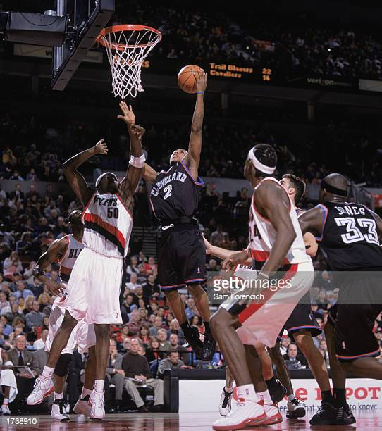 Dujuan Wagner of the Cleveland Cavaliers to the basket over Zach Randolph of the Portland Trail Blazers during the NBA game at The Rose Garden on...
