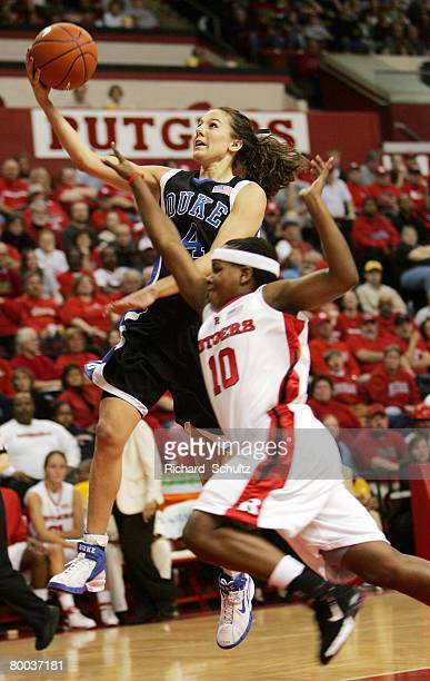 Duke Blue Devils' Abby Waner takes a shot as Rutgers Scarlet Knights' Epiphanny Prince attempts to defend during the first half of game at the...