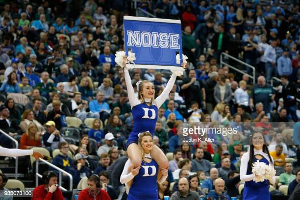Duke Blue Devils cheerleaders perform against the Rhode Island Rams during the first half in the second round of the 2018 NCAA Men's Basketball...
