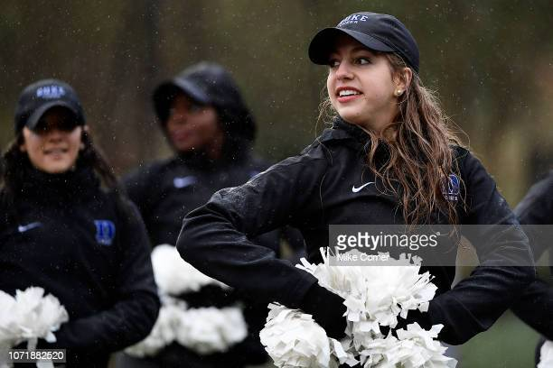 Duke Blue Devils cheerleaders perform in the rain during the Blue Devils' football game against the Wake Forest Demon Deacons at Wallace Wade Stadium...