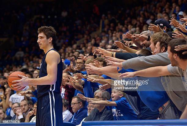 Duke Blue Devils fans taunt Nick Victor of the Yale Bulldogs as he inbounds the ball during their game at Cameron Indoor Stadium on November 25, 2015...
