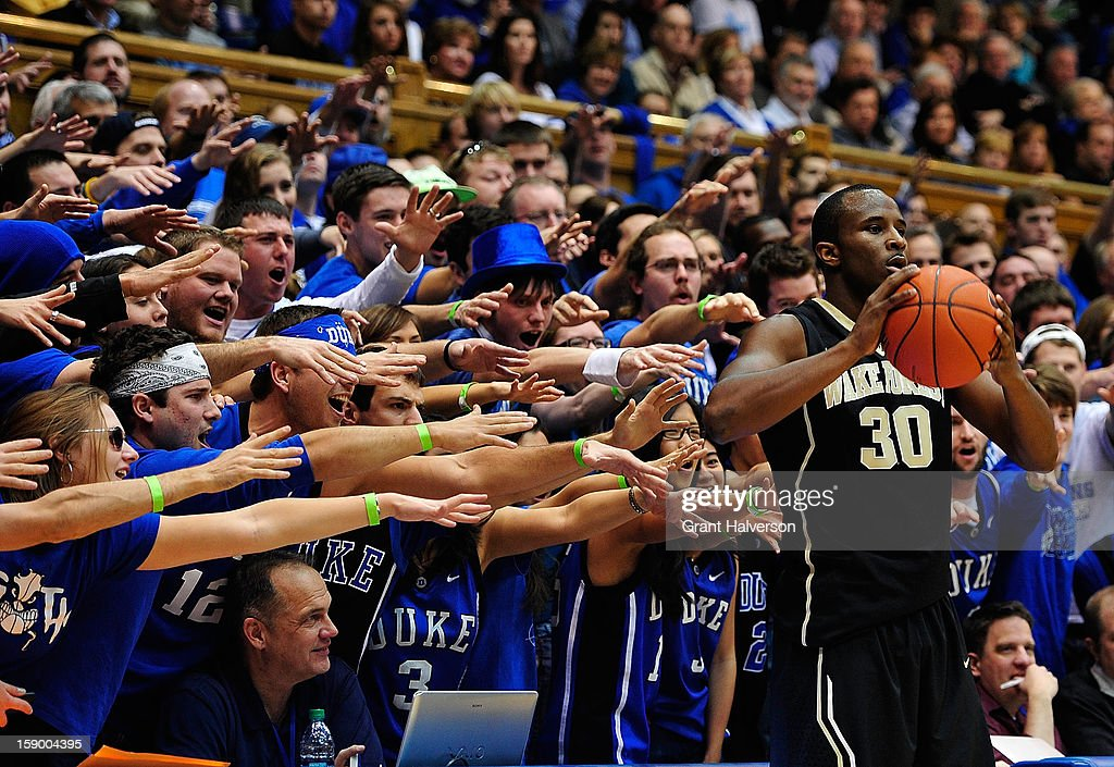 Duke Blue Devils fans taunt Travis McKie #30 of the Wake Forest Demon Deacons as he prepares to inbound the ball during play at Cameron Indoor Stadium on January 5, 2013 in Durham, North Carolina.