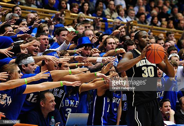 Duke Blue Devils fans taunt Travis McKie of the Wake Forest Demon Deacons as he prepares to inbound the ball during play at Cameron Indoor Stadium on...