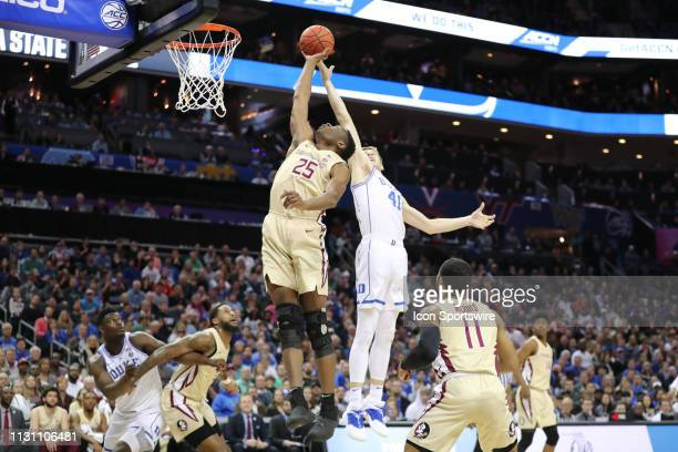 Duke Blue Devils forward Jack White goes for the dunk while Florida State Seminoles forward Mfiondu Kabengele blocks it during the 1st half of the...