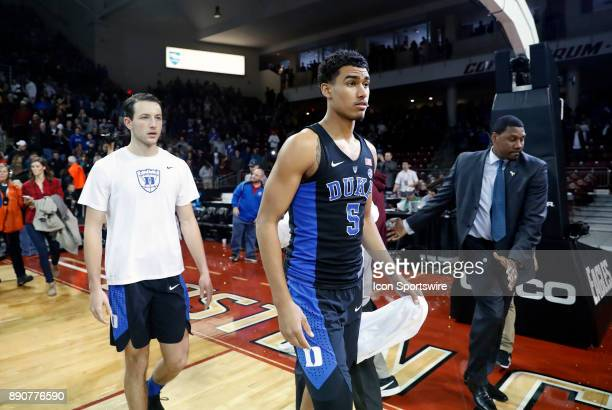 Duke Blue Devils forward Jordan Tucker is ushered off the court during a game between the Boston College Eagles and the Duke University Blue Devils...