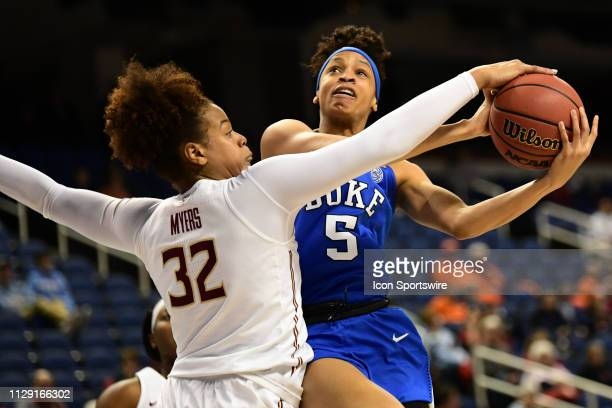 Duke Blue Devils forward Leaonna Odom is blocked by Florida State Seminoles forward Valencia Myers during the ACC Women's basketball tournament...