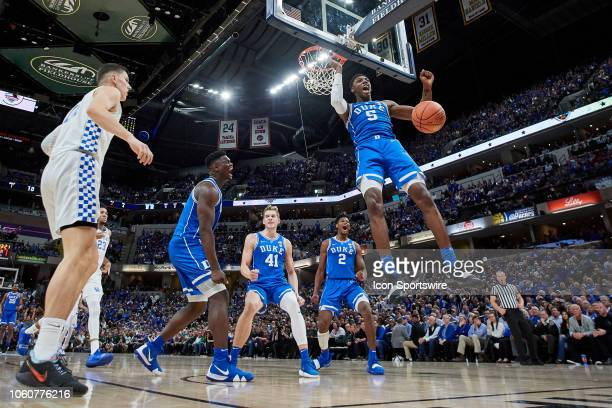 Duke Blue Devils forward RJ Barrett battles to dunk the basketball in action during a Champions Classic game between the Duke Blue Devils and the...
