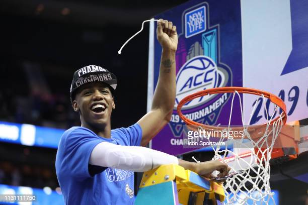 Duke Blue Devils forward RJ Barrett cuts the net at the end of the of the ACC Tournament championship game with the Duke Blue Devils versus the...