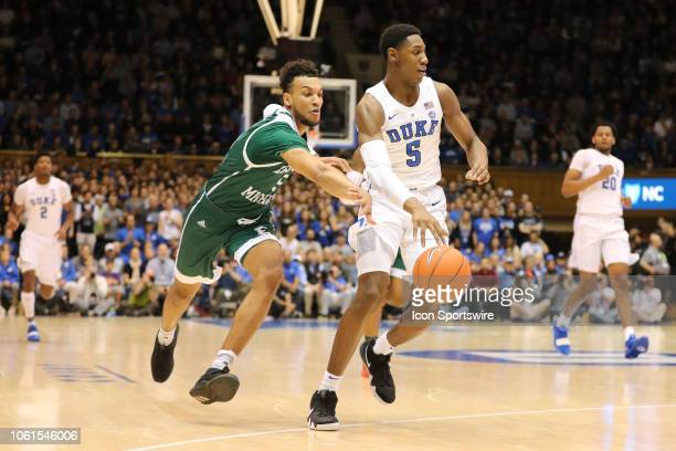 Duke Blue Devils forward RJ Barrett with what ball while Eastern Michigan Eagles forward Elijah Minnie attempts to get it during the 1st half of the...