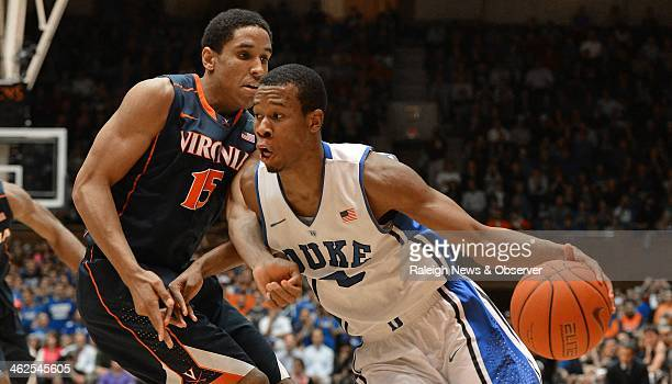 Duke Blue Devils forward Rodney Hood moves the ball inside against Virginia Cavaliers guard Malcolm Brogdon during the second half of play at Cameron...