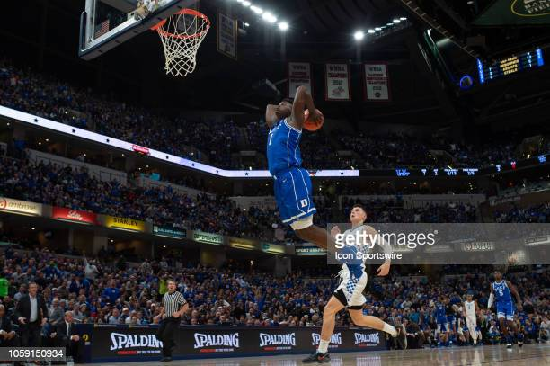 Duke Blue Devils forward Zion Williamson goes up for a dunk on a fast break during the State Farm Champions Classic basketball game between the Duke...
