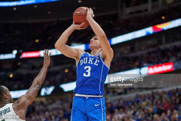 Duke Blue Devils guard Grayson Allen shoots a three point basket during the State Farm Classic Champions Classic game between the Duke Blue Devils...