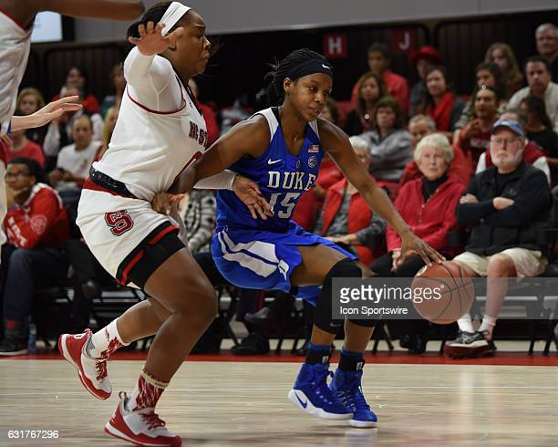 Duke Blue Devils guard Kyra Lambert drives by North Carolina State Wolfpack guard Camille Anderson during a game between the Duke Blue Devils and the...