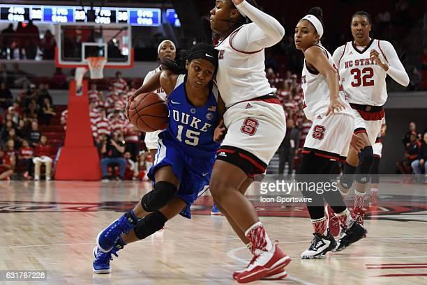 Duke Blue Devils guard Kyra Lambert drives into North Carolina State Wolfpack guard Camille Anderson during a game between the Duke Blue Devils and...