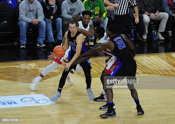 Duke Blue Devils guard Luke Kennard center steals the ball away from UNLV forward Cheicknab Dembele as Amile Jefferson and Uche Ofoegbu look on in...