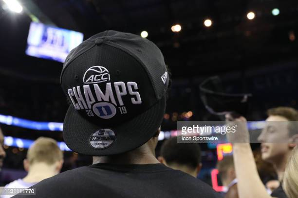 Duke Blue Devils guard Mike Buckmire wearing the winning hat at the end of the of the ACC Tournament championship game with the Duke Blue Devils...