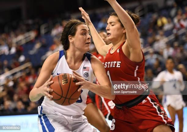 Duke Blue Devils guard Rebecca Greenwell posts up onNorth Carolina State Wolfpack guard Aislinn Konig during the ACC women's tournament game between...