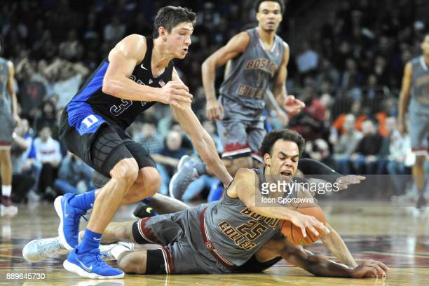 HILL MA Duke Blue Devils guard Trevon Duval and Boston College Eagles guard Jordan Chatman dive for the loose ball at mid court and Duke Blue Devils...