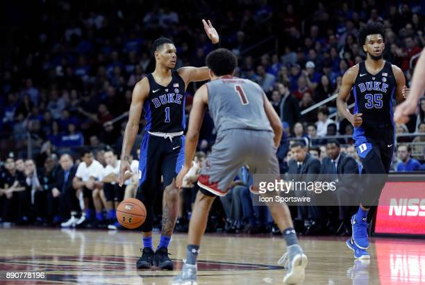 Duke Blue Devils guard Trevon Duval calls the play watched by Boston College guard Jerome Robinson during a game between the Boston College Eagles...