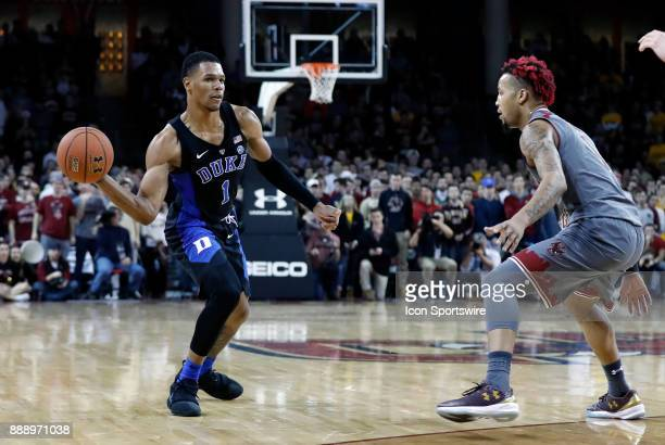 Duke Blue Devils guard Trevon Duval passes watched by Boston College guard Ky Bowman during a game between the Boston College Eagles and the Duke...