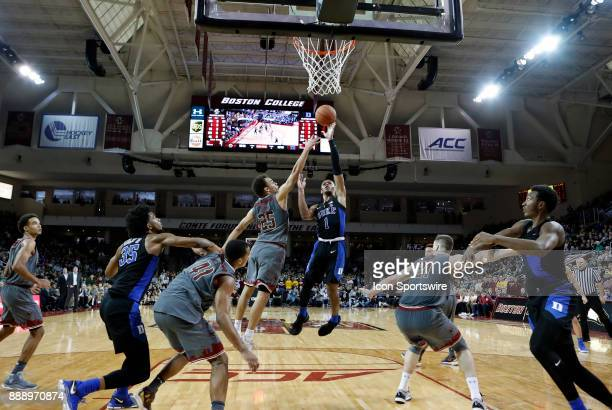 Duke Blue Devils guard Trevon Duval shoots over Boston College guard Jordan Chatman during a game between the Boston College Eagles and the Duke...