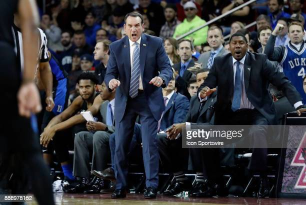 Duke Blue Devils head coach Mike Krzyzewski yells at his team as time winds down during a game between the Boston College Eagles and the Duke...