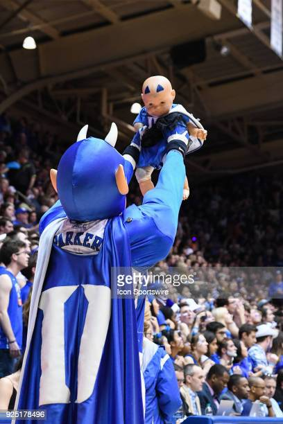 Duke Blue Devils mascot lifts a baby doll up during the men's college basketball game between the Syracuse Orange and the Duke Blue Devils on...