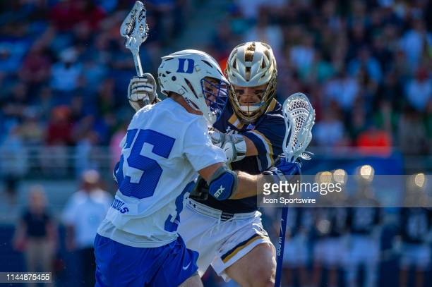 Duke Blue Devils midfielder Joe Stein advances the ball during the first half of the NCAA Lacrosse Championships quarterfinals game between the Duke...