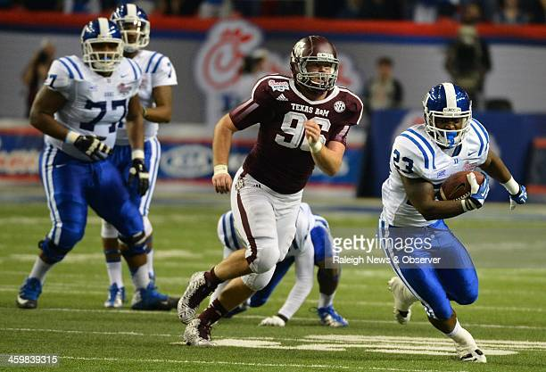Duke Blue Devils running back Juwan Thompson gets past Texas AM Aggies defensive lineman Jay Arnold for a first down during the second quarter in the...