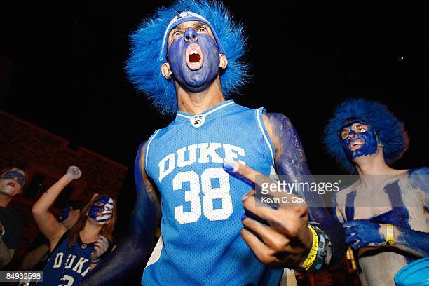 Duke Blue Devils students decorate themselves with paint prior to the start of the annual showdown with the North Carolina Tar Heels in a makeshift...
