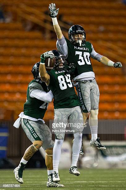 Duke Bukoski Ryan Pasoquen and Gaetano DeMattei of the Hawaii Warriors celebrate Pasoquen's retrieval of an onside kick during the second half of a...