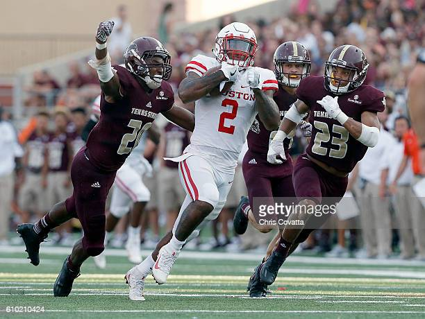Duke Catalon of the Houston Cougars races down the field against Stephan Johnson and Clarence Guidry III of the Texas State Bobcats at Bobcat Stadium...