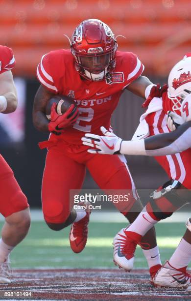 Duke Catalon of the Houston Cougars runs the ball up the middle during the first quarter of the Hawaii Bowl against the Fresno State Bulldogs at...