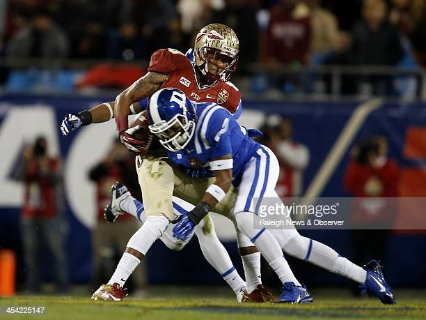 Duke cornerback Deondre Singleton puts a big hit on Florida State wide receiver Rashad Greene causing an incompletion during the first half at Bank...