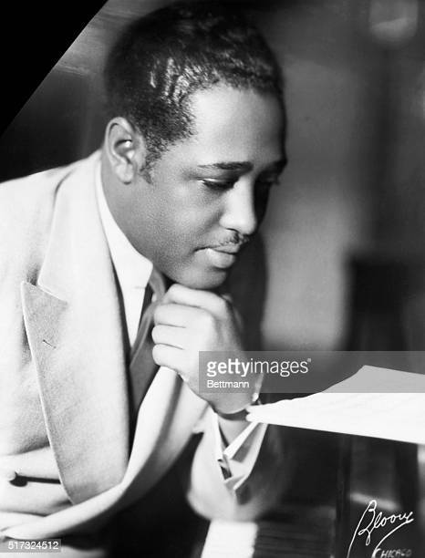 Duke Ellington American composer and arranger at the piano after his return from Europe Halflength photograph 1934