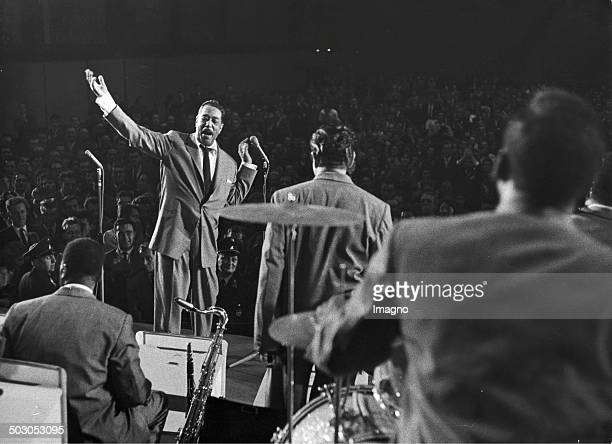 Duke Ellington and his orchestra receiving applause from the audience at a concert Photograph by Fran Hubmann Ca 1965