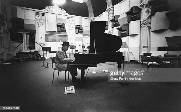 Duke Ellington sits at a grand piano arranging the score of the film Paris Blues in 1960 in Paris France