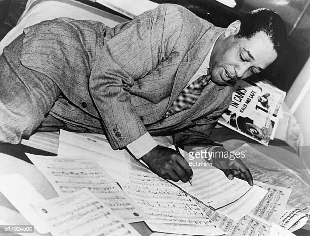 Duke Ellington writing on scores of music Undated photograph