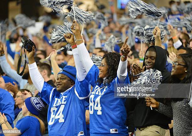 Duke fans cheer on the Blue Devils during a firstquarter touchdown against the Texas AM Aggies by quarterback Brandon Connette in the ChickfilA Bowl...