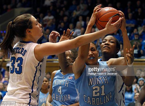 Duke forward Haley Peters and forward Richa Jackson contest a rebound with North Carolina forward Krista Gross during game action at Cameron Indoor...