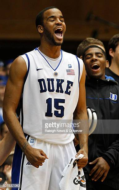 Duke forward Josh Hairston and teammate Kyrie Irving get excited after a thunderous dunk by teammate Nolan Smith in the first half of play against St...