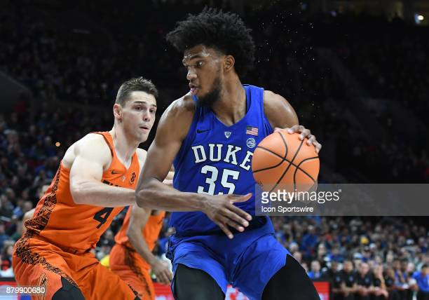 Duke forward Marvin Bagley III looks to drive to the basket against Florida guard Egor Koulechov in the championship game of the Motion Bracket at...