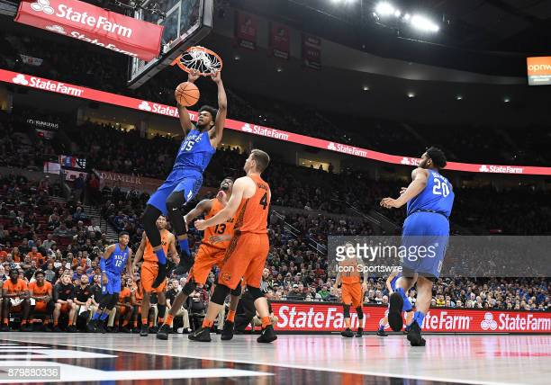 Duke forward Marvin Bagley III slams home the ball over Florida forward/center Kevarrius Hayes and Florida guard Egor Koulechov in the championship...