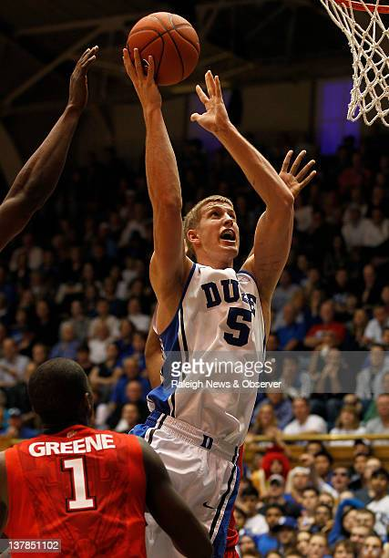 Duke forward Mason Plumlee goes in for two points as St. John's guard Phil Greene watches during game action at Cameron Indoor Stadium in Durham,...
